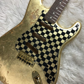 Checkered Mercury Pickguard - Gold/Black (Stratocaster type)