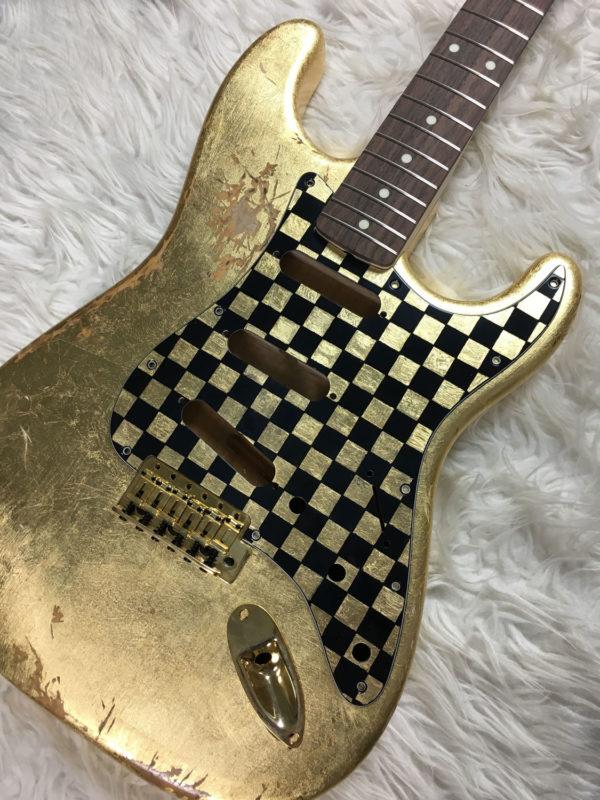 Checkered Mercury Pickguard - Gold/Black (Stratocaster type)